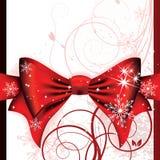 Arqueamiento rojo grande en una carta mágica de la Navidad Imagenes de archivo