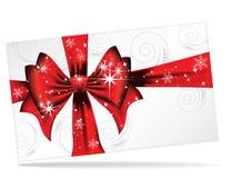 Arqueamiento rojo grande en una carta mágica de la Navidad Fotos de archivo