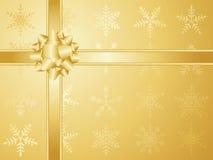 Arqueamiento y cintas de la Navidad del oro Foto de archivo