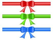 Arqueamientos festivos de la cinta del regalo Imágenes de archivo libres de regalías