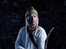 Arqueiro medieval com uma curva e as setas Foto de Stock