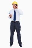 Arquitecto de sexo masculino en su teléfono celular Fotografía de archivo libre de regalías