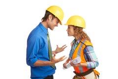 Arquitecto enojado And Construction Worker Imagenes de archivo