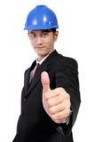 Arquitecto joven que da el pulgar para arriba, aislado en blanco Imagen de archivo