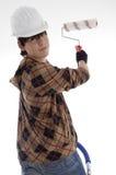 Arquitecto joven sonriente con el cepillo de pintura Foto de archivo libre de regalías