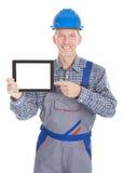 Arquitecto que muestra la tableta digital fotografía de archivo libre de regalías