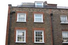 Arquitectura georgiana en una casa de la pared, Londres, Reino Unido de las ventanas Fotografía de archivo