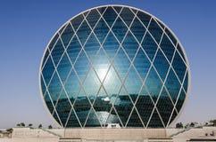 Arquitectura moderna Abu Dhabi del HQ de Aldar Foto de archivo libre de regalías