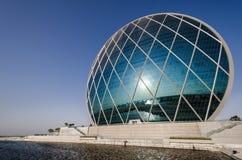 Arquitectura moderna Abu Dhabi del HQ de Aldar Imagen de archivo libre de regalías