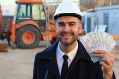 Arquiteto com lotes do dinheiro à disposição fotos de stock royalty free