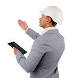 Arquiteto ou coordenador novo que fazem uma inspeção fotos de stock royalty free