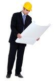 Arquiteto que inspeciona planos da construção Imagem de Stock Royalty Free