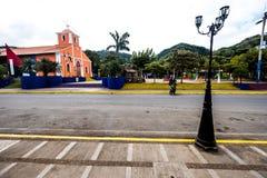 Arquitetura colorida da igreja Católica do turista do turismo das construções da rua da igreja de Granada Nicarágua Imagens de Stock