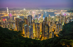Arquitetura da cidade clara da noite do distrito central e do Kowloon, Hong Kong Foto de Stock Royalty Free