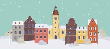Arquitetura da cidade do inverno com construções velhas coloridas Cidade velha no inverno Fotografia de Stock Royalty Free
