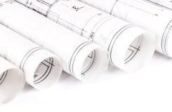 A arquitetura rola modelos do arquiteto dos planos arquitetónicos Imagem de Stock Royalty Free