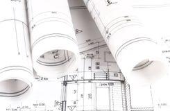 A arquitetura rola modelos do arquiteto dos planos arquitetónicos Imagem de Stock