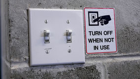 Arrêtez l'interrupteur de lampe en enregistrant le concept de puissance Image stock