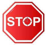 Arrêtez le signe avec l'horloge Photo stock