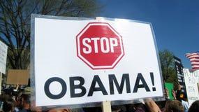 Arrêtez le signe d'Obama au rassemblement Image libre de droits