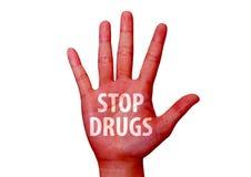Arrêtez les drogues écrites sur une main Photo stock