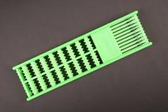 Arrêts verts d'un supplément de cheveux Images stock