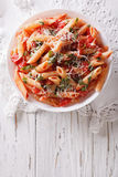 Arrabiata pasta penne with Parmesan cheese. vertical top view Royalty Free Stock Images