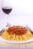 Arrabiatta pasta and wine Royalty Free Stock Photography