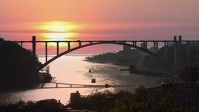 The Arrabida bridge in Porto, Portugal. The Arrabida bridge over the Douro River in the rays of the setting sun. Porto, Portugaln stock footage