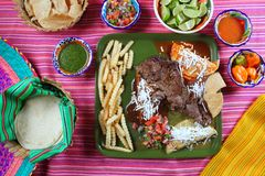 Arrachera beef flank steak Mexican dish. Assorted chili sauces Mexico spiced royalty free stock photos