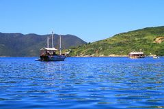 Arraial do Cabo - Boats Navigating. Photo showing some boats navigating in Arraial do Cabo - Rio de Janeiro Stock Images