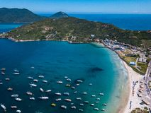 Arraial do Cabo Brazil. Praia dos Anjos. Aerial drone photo from above. Beach ocean and fishing boats. Amazing blue sky. And water. Lovely uncharted brazilian stock image