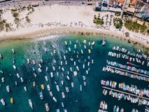 Arraial do Cabo Brazil. Praia dos Anjos. Aerial drone photo from above. Beach ocean and fishing boats. Amazing blue sky and water stock photos