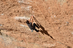Go up, because he does not like down. Climber on rock Royalty Free Stock Images