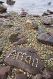 `Arran` in pebbles on beach on  the Isle of Arran. `Arran` in pebbles on beach on the Isle of Arran in Scotland Stock Photography