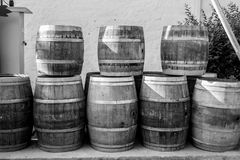 Arrange of barrels. Black and white barrels organized stock photo