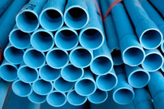 Arrange blue pipe in stock Stock Images