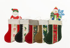 Arrange of Christmas sock with Santa and Snow man Stock Images