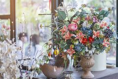 Arrange the flowers in the vase . stock photos