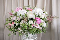 Arrange flowers in a white roman vase.  Stock Photo