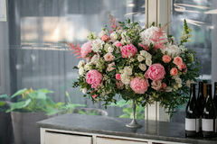 Arrange flowers in a white roman vase.  Royalty Free Stock Photography