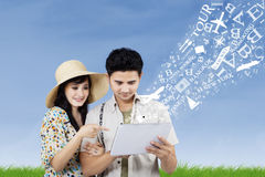 Arrange honeymoon travel from electronic tablet Royalty Free Stock Photography