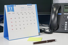 Arrange November meeting on calendar with phone discussion royalty free stock images