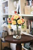 Arrange of Petal Flower in Clear Glass Vase at Table Royalty Free Stock Photo