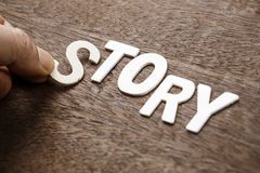 Arrange Story Topic. Hand arrange wood letters as STORY word Royalty Free Stock Photos