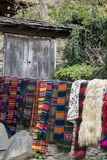 Arranged carpets and loose woven fabrics in various colors according to the old Bulgarian technology. stock photo
