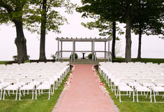 Arranged chairs. White chairs arranged and setup for a wedding ceremony Royalty Free Stock Image