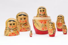arranged close doll family hand like looking matryoshka nested painted together unique upwards which white wooden Royaltyfri Foto