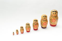 arranged close doll family hand like looking matryoshka nested painted together unique upwards which white wooden Στοκ Εικόνα