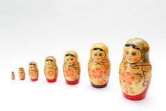 arranged close doll family hand like looking matryoshka nested painted together unique upwards which white wooden Arkivfoto